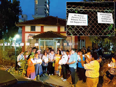 Christian groups gather outside Adelaide bungalow in Bandra to support Russell and Winifred Pereira