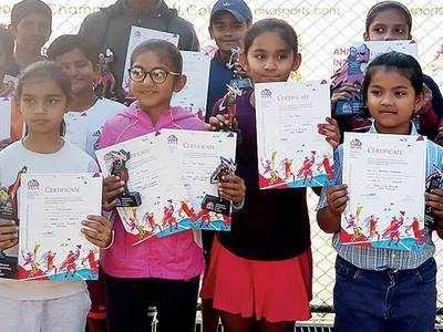 Local kids star in tennis tourney