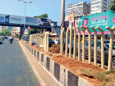 Railings to stop jaywalking on marine drive