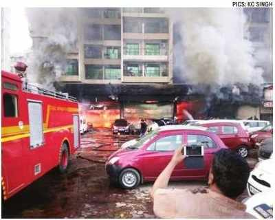 Two burnt to death in fire at Kharghar car showroom