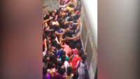 Watch: Hostile conditions women go through every day to board Mumbai local