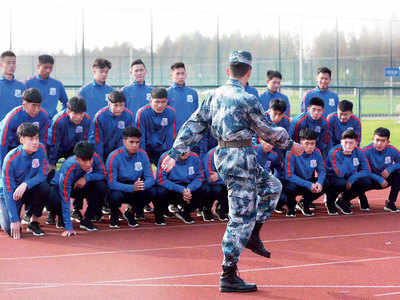 CHINESE PLAYERS GET ARMY DRILLS, 'THOUGHT EDUCATION'