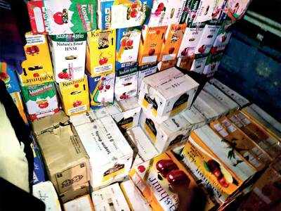 IMFL worth Rs 20 lakh hidden between apple crates seized