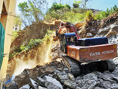 Collector's office asks  private developer to stop digging up Gilbert Hill; BJP leader says charges must be filed for destroying protected heritage column