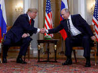 Donald Trump-Vladimir Putin meet: US president embraces foe, dismisses own intel