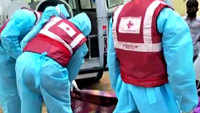 Red Cross volunteers carry body of COVID-19 patient in special ambulance