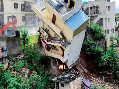 Two more buildings tilt, third collapses