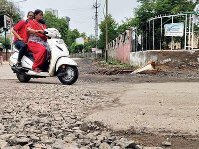 Rain leaves Bopal-Ghuma road in flood of woes