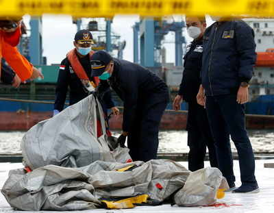 Body parts found at Indonesian plane crash site