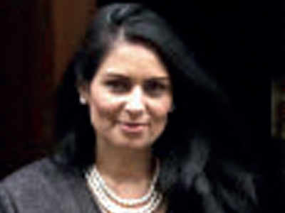British PM backs Priti Patel over bullying report