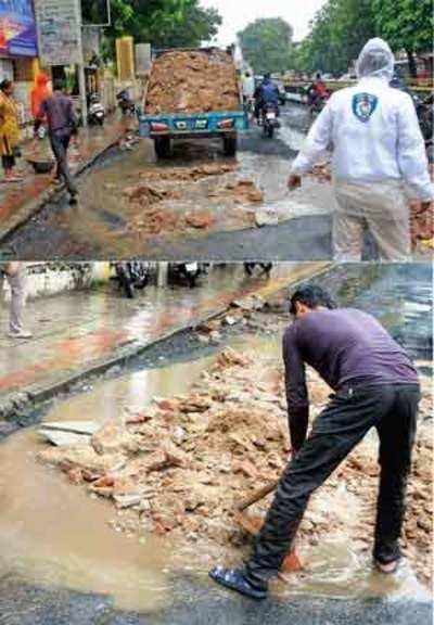 Traffic cops at Sola signal fill up potholes to avert mishaps