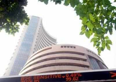 Sensex, Nifty slip from record highs, turn red