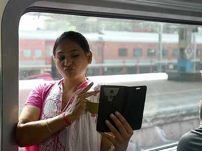 Mumbaikars welcome new AC local in style