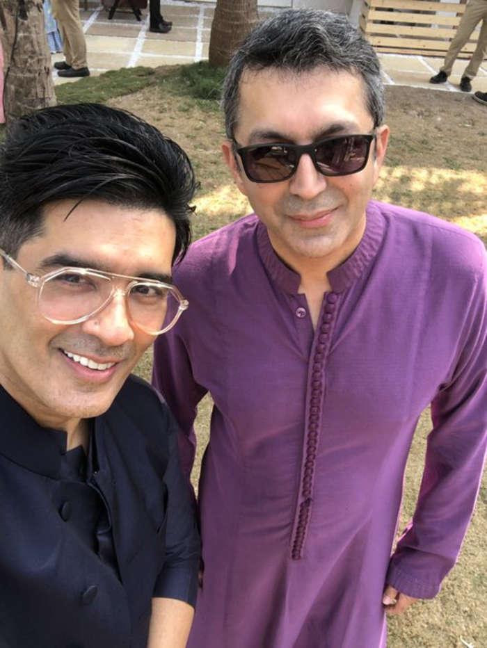 Manish Malhotra and Kunal Kohli pose for a selfie at Varun-Natasha's wedding