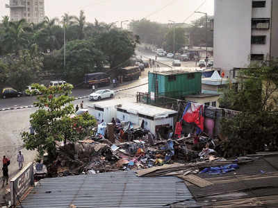 Major junction cleared as BMC razes 37 huts, will reduce travel time from Annie Besant Road to Worli sea face