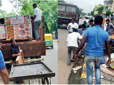 Roadside stalls removed from Law Garden, C G Road, Ankur