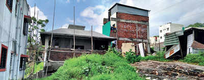 PMC slaps notices on over 150 plot buyers for illegal structures on hill