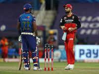 Mumbai beat Bangalore, all but through to playoffs