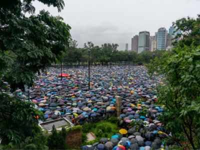 Hong Kong: Tens of thousands rally despite heavy rain for peaceful protest