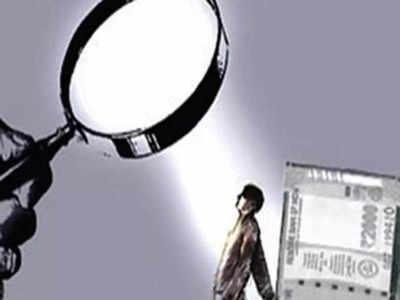 I-T raids uncover Rs 750 crore in black money