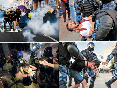 Riot police fire tear gas at HK protesters