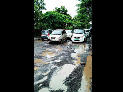 Road to Pashan Circle filled with potholes