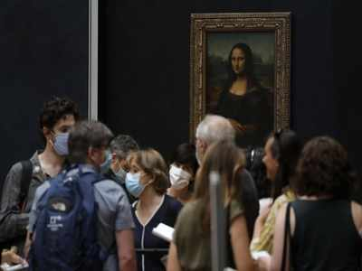 Mona Lisa back at work, visitors limited, as Louvre reopens