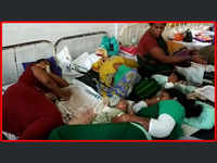 Overburdened: Three mothers with their new-born babies share single bed at a government hospital in Visakhapatnam