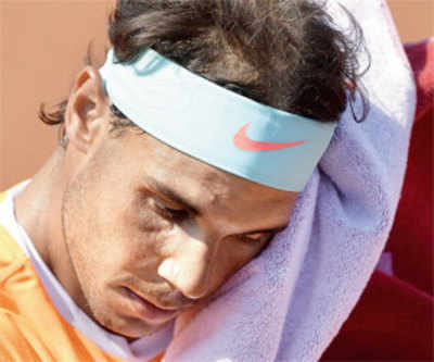 Below-par Nadal to use old racquet for rest of the season