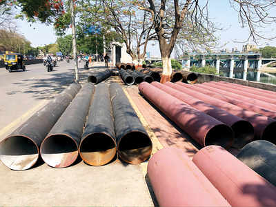 Pipes eat up footpath of Deccan College Road