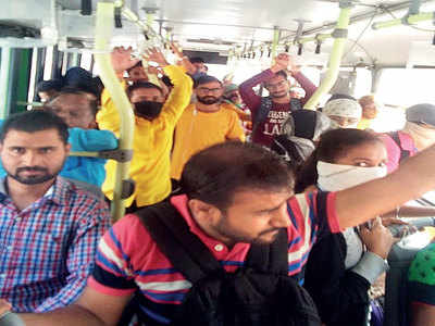 Coronavirus outbreak: Large crowd swarms fewer PMPML buses
