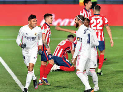 Real Madrid inflicts La Liga leader Atlético's first loss this season