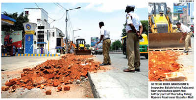 Bruhat Bengaluru Mahanagara Palike creates concrete trouble and traffic cops fix it with bricks