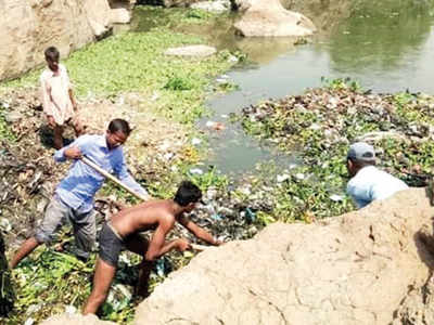 PCMC in hot water for FB images of staff cleaning drains sans safety gear