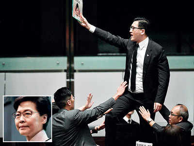 Hong Kong leader heckled in House, abandons speech