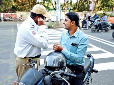 Traffic cops conduct drive to book riders using earphones