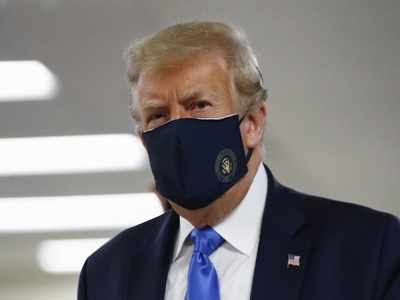 Donald Trump finally dons mask as US sets new virus case record