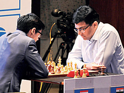 Mixed day for Viswanathan Anand; Magnus Carlsen extends lead