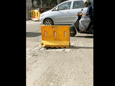 Broken manhole cover a mishap risk on Karve Road