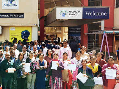 Parents protest over fee hike by Amanora School