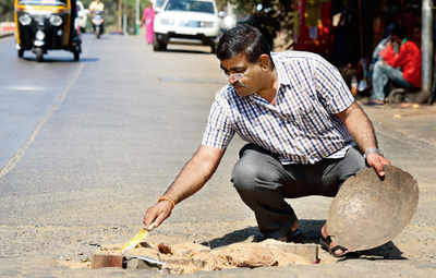 A dad fills up city's potholes, to fix the hole in his heart