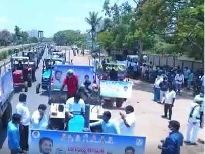 Andhra Pradesh: YSR Congress MLA Kaveti Sanjeevaiah holds tractor rally with grocery for the poor