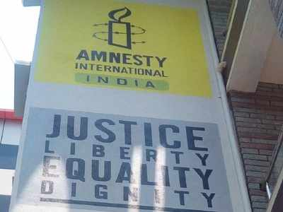 Amnesty India halts operations after govt freezes its bank accounts; accuses GoI of witch-hunt of human rights organisations