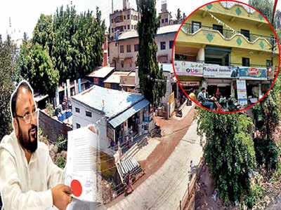 Babus pulled up for not acting against influential persons' illegal building