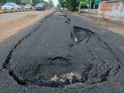 Roads caving in across city, AMC to supervise Torrent's work