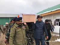 Rajnath Singh carries coffin of slain CRPF soldier killed in Pulwama attack