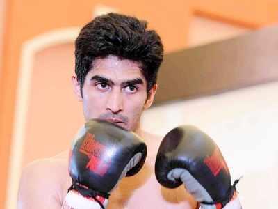 Boxing star Vijender Singh wins 11th consecutive pro bout