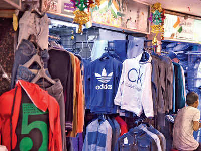 Two shop owners on FC Road booked for selling fake goods