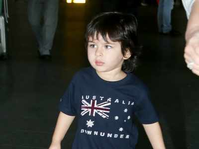 Photos: Taimur Ali Khan, Kareena Kapoor Khan twin in blue as they return to Mumbai