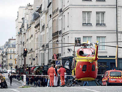 Four officers knifed to death at Paris police HQ